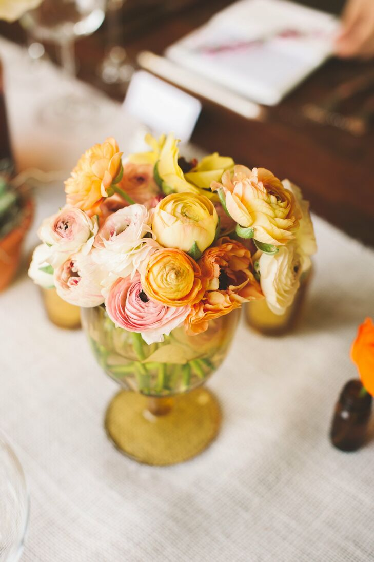 The couple filled vintage vases with ranunculus and dahlias for their centerpieces.