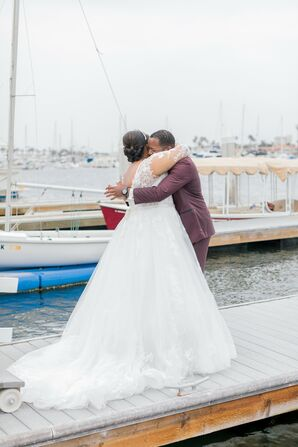 Couple Hugging During Portraits by Boat Piers