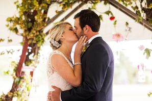 First Kiss Under Rustic Floral Wedding Arch