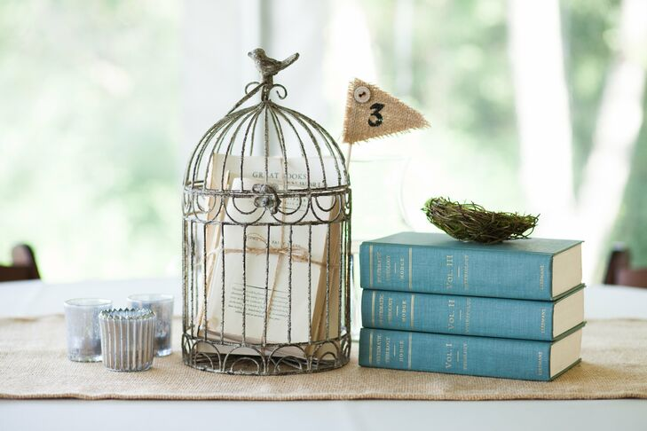 Centerpieces incorporated antique books and birdcages, complementing the rustic chic vibe the couple was after.