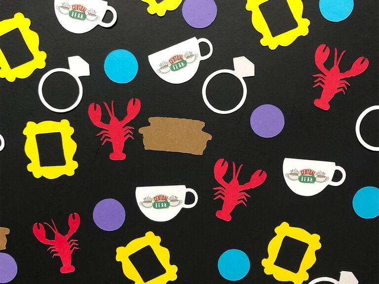 Friends themed confetti like lobster, engagement ring, Central Perk mug, etc.