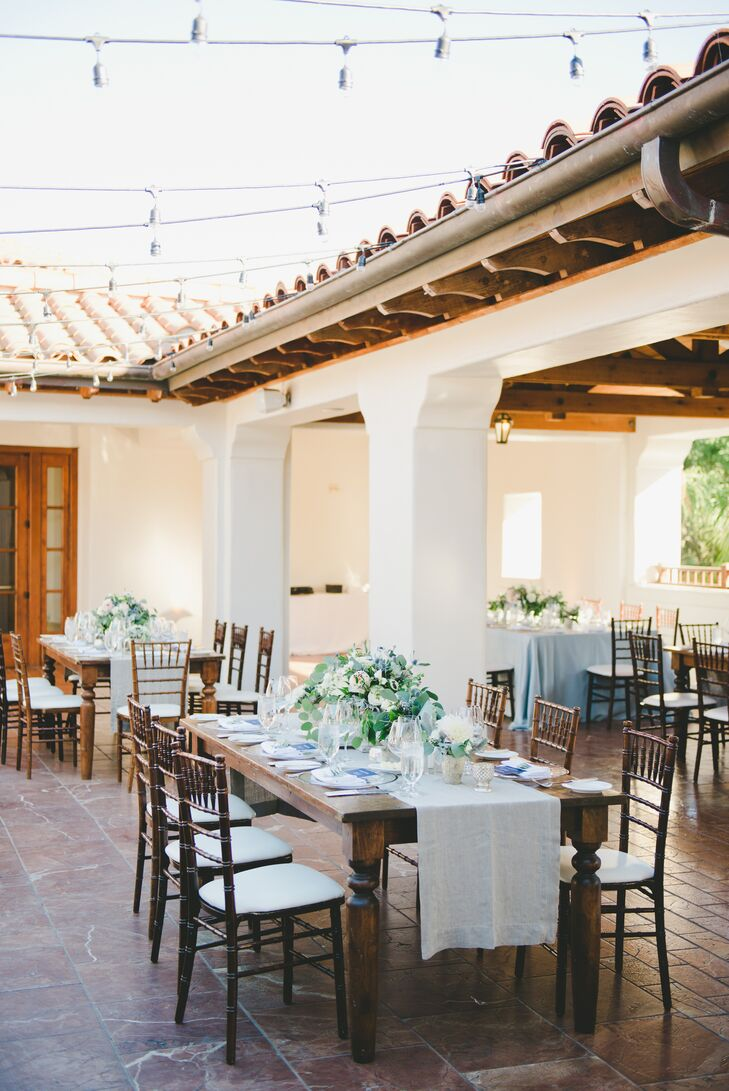 """After the ceremony, Ivette and Alberto gathered their guests at the Rotunda Terrace for dinner and dancing. Guests continued to enjoy views of the water, while stars and strands of brightly lit bistro lights twinkled overhead. """"We aimed for a modern contrast with the rustic elements of our venue, which was stylistically Spanish,"""" Ivette says."""