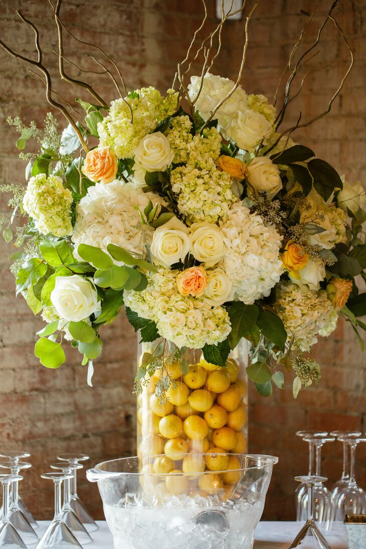 A lemon-filled vase added a fresh, playful touch to the floral centerpieces.