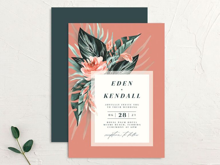 Coral wedding invitation with tropical flower motif