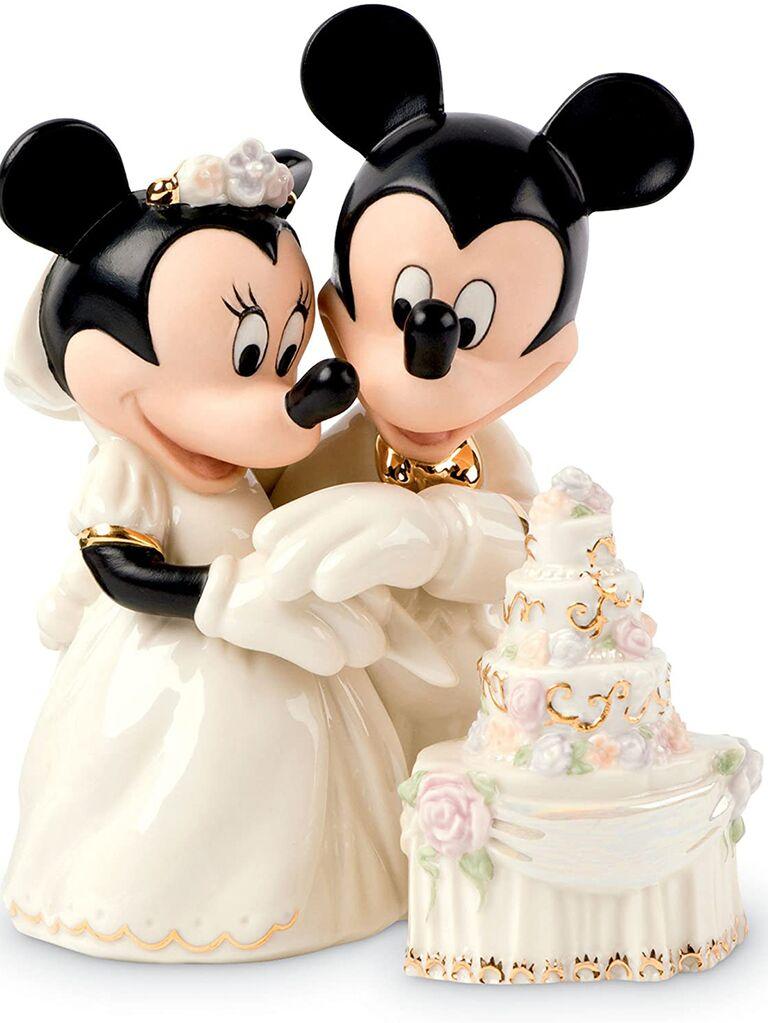 Ceramic Mickey and Minnie in wedding attire cutting cake