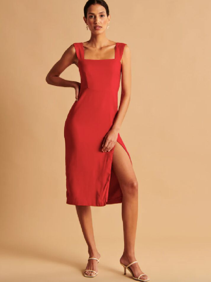 Red midi fall wedding guest dress with thick shoulder straps and leg slit