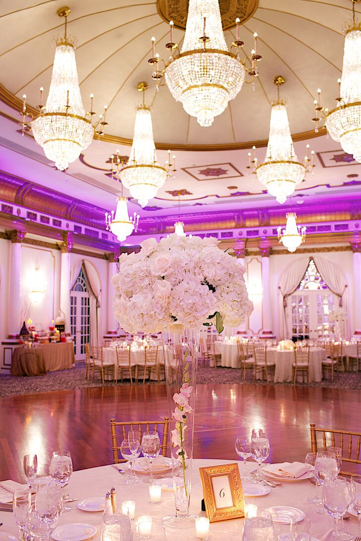"""""""The Crystal Plaza has the look and feel of a historic mansion with a regal and elegant feel indoors,"""" Jessica says. """"The ballroom is large with gold molding and large chandeliers. Because our theme colors were gold, pink and ivory, the ballroom was perfect!"""""""