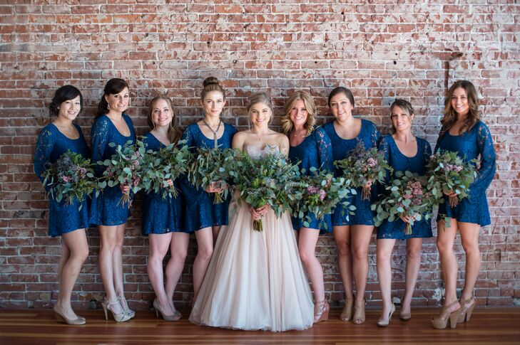 """A designer in Los Angeles, California, Alexandra took her bridesmaid dresses as seriously as her own. """"I mostly cared that my bridesmaids were comfortable. I'm not a fan of traditional or uniform things, so when my company gifted me the dresses for my bridesmaids, I was thrilled, and I insisted they each dress them up however they liked,"""" she says. The navy lace dresses had retro bell sleeves and fit perfectly with the wedding's modern bohemian vibe."""